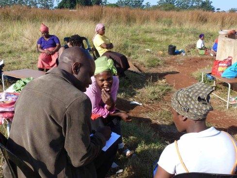 Joseph Zulu (L) interviewing Mambane residents