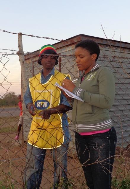Swazi Observer reporter Winile Masinga (r) interviewing a Mafutseni resident