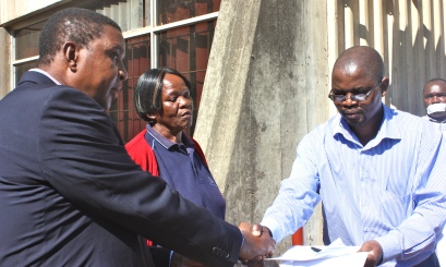 MISA-Swaziland chairman Alec Lushaba (R) presenting the media freedom petition to ministry of justice under-secretary Siboniso Masilela