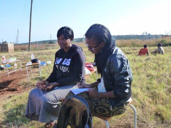 Times of Swaziland reporter Nontobeko Tshabalala interviewing in Mambane