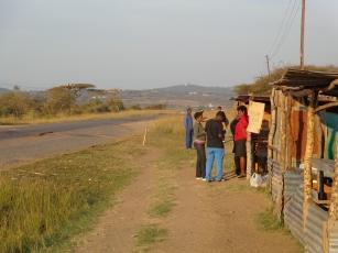 Swazi Observer reporter Winile Masinga & Times of Swaziland reporter Kwanele Dhladhla interviewing residents in Mafutseni