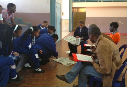 Checking the news at Sifundzani High School