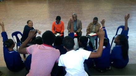 Students at Sifundzani High School asking journalists questions about how they report