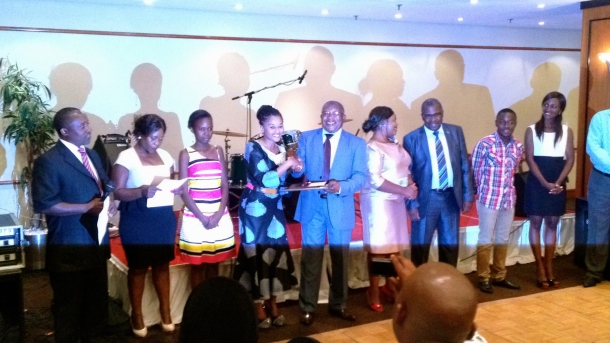 Sithembile Hlatshwayo receiving MISA and Save the Children award in Zambia
