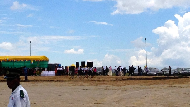 Dignitaries arriving in the distance