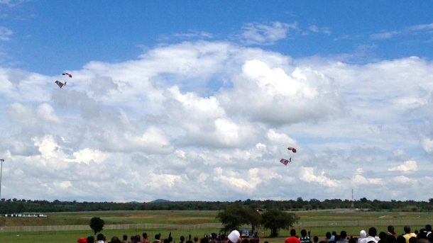 Parachuters entertained the crowd in the lead up the the speeches