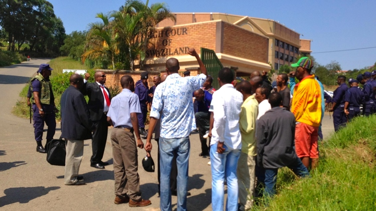 Political activists protesting outside the high court of Swaziland after journalist Bheki Makhubu and lawyer Thulani Maskeo were ordered back into detention