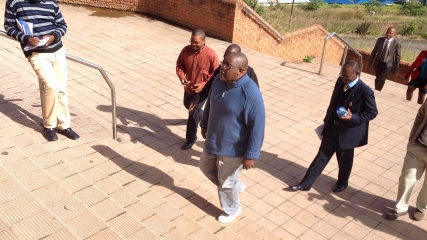 Journalist Bheki Makhubu (in blue sweater) and lawyer Thulani Maseko (in suit) were allowed to come to court yesterday without the leg chains that have been around their ankles on previous court appearances