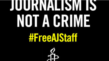 Amnesty International poster calling for release of Al-Jazeera journalists in Egypt