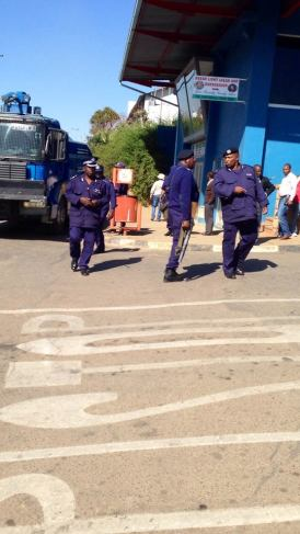Police outside Swaziland's high court after a judge sentenced two writers to two years in jail